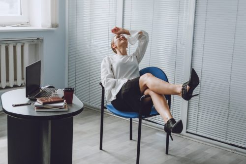 Young business woman take it easy working and resting in office. Niksen, do nothing, overwork, Life quality, living balance concept.